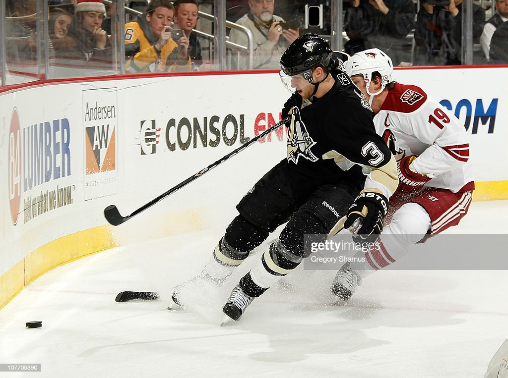 Alex Goligoski of the Pittsburgh Penguins battles for the puck against Shane Doan of the Phoenix Coyotes on December 15 2010 at Consol Energy Center...