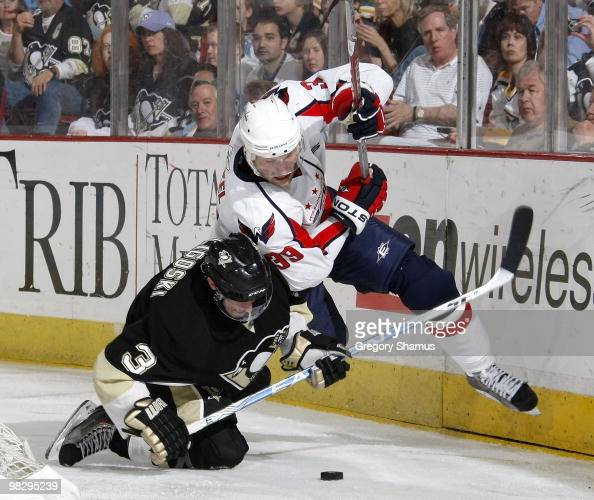 Alex Goligoski of the Pittsburgh Penguins trips up David Steckel of the Washington Capitals on April 6 2010 at Mellon Arena in Pittsburgh Pennsylvania