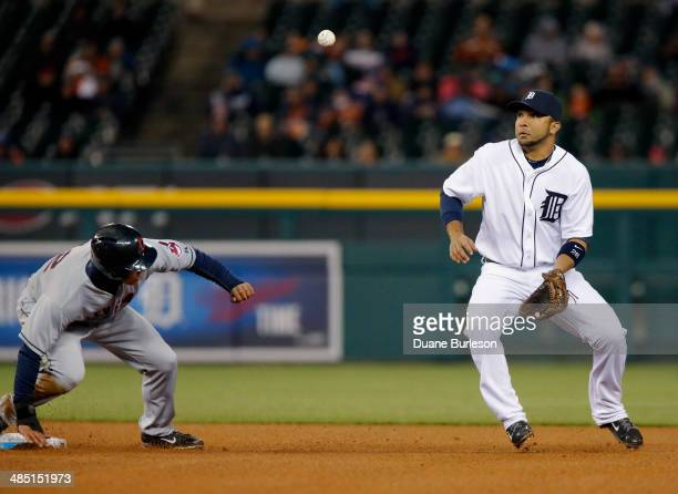Alex Gonzalez of the Detroit Tigers keeps an eye on the ball after the pickoff throw hit Michael Brantley of the Cleveland Indians in the back in the...