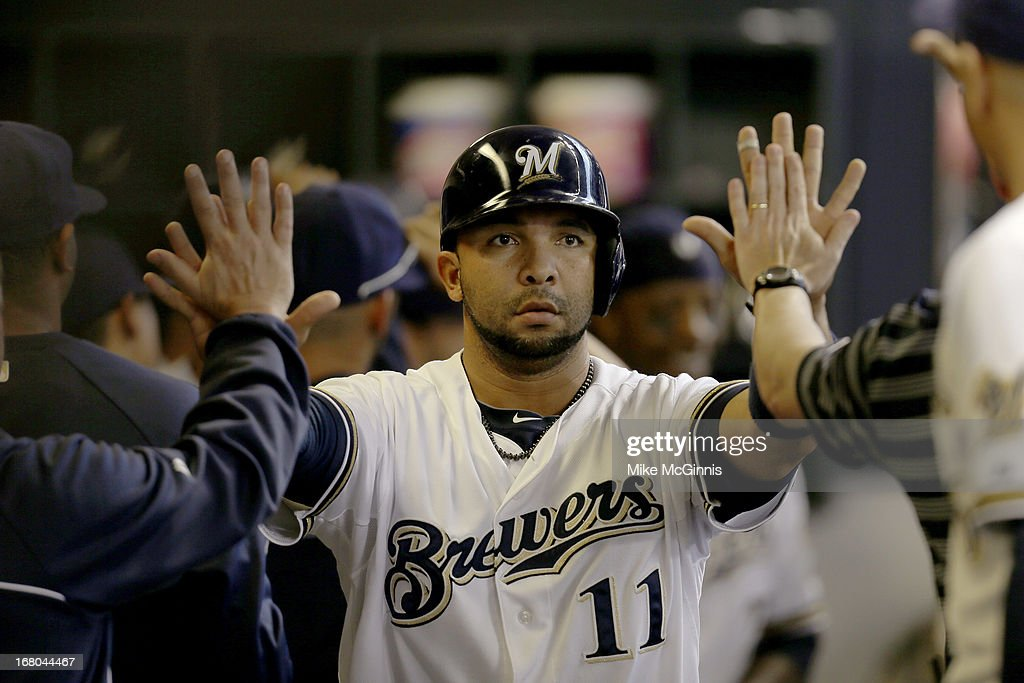 Alex Gonzalez #11 of the Milwaukee Brewers celebrates in the dugout after reaching on a single hit by Jonathan Lucroy in the bottom of the sixth inning against the St. Louis Cardinals at Miller Park on May 04, 2013 in Milwaukee, Wisconsin.