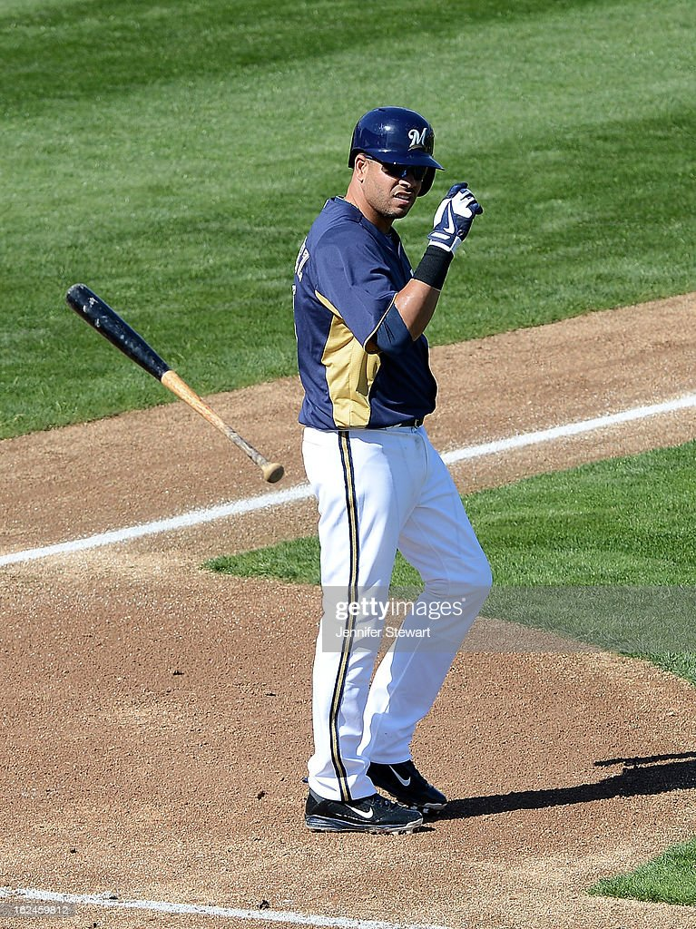 Alex Gonzalez #16 of the Milwaukee Brewers throws his bat after striking out against the Oakland Athletics during the spring training game at Maryvale Baseball Park on February 23, 2013 in Phoenix, Arizona.
