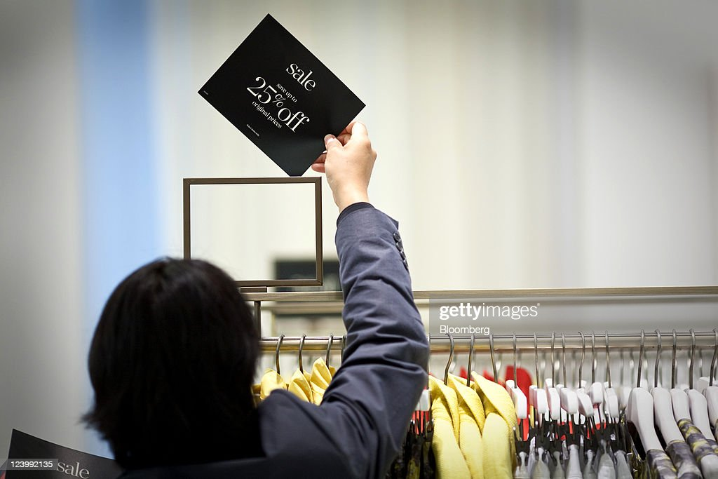 Alex Gonzalez, Store Manager For Talbots Inc., Displays A Sale Sign At A