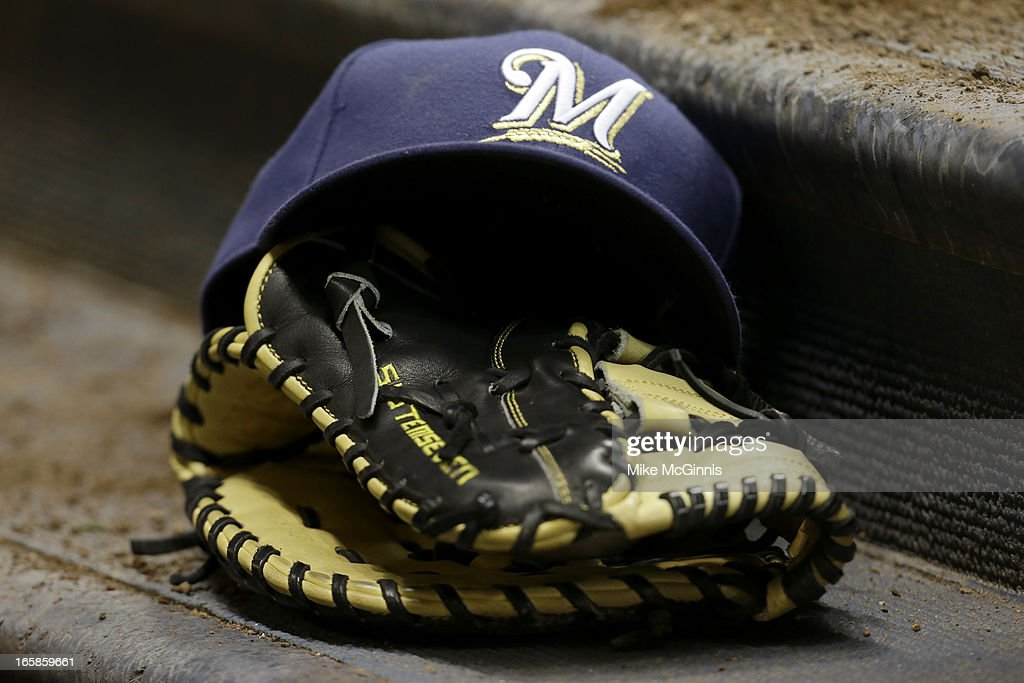 Alex Gonzalez's of the Milwaukee Brewers cap and glove sit on the step to the dugout during the game against the Colorado Rockies at Miller Park on April 2, 2013 in Milwaukee, Wisconsin.