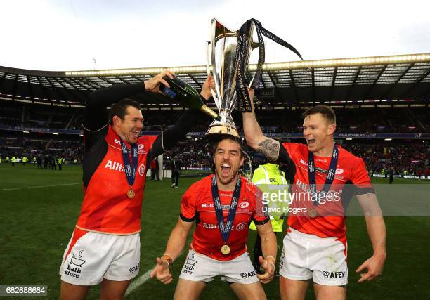 Alex Goode Chris Wyles and Chris Ashton of Saracens celebrate with the trophy following his team's 2817 victory during the European Rugby Champions...