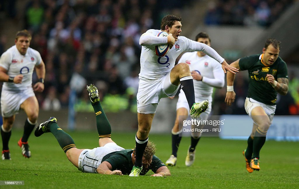 <a gi-track='captionPersonalityLinkClicked' href=/galleries/search?phrase=Alex+Goode&family=editorial&specificpeople=2060375 ng-click='$event.stopPropagation()'>Alex Goode</a> of England breaks away from Jannie du Plessis of South Africa during the QBE International match between England and South Africa at Twickenham Stadium on November 24, 2012 in London, England.