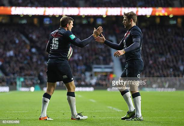 Alex Goode of England celebrates scoring his team's sixth try with his team mate Elliot Daly during the Old Mutual Wealth series match between...