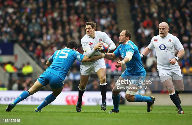Alex Goode of England charges through Andrea Masi of Italy and Sergio Parisse of Italy during the RBS Six Nations match between England and Italy at...