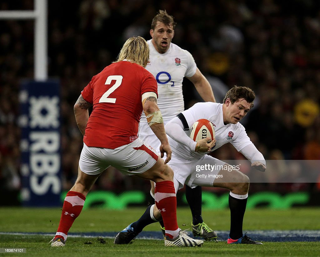 Alex Goode of England is challenged by Richie Hibbard of Wales during the RBS Six Nations match between Wales and England at Millennium Stadium on March 16, 2013 in Cardiff, Wales.