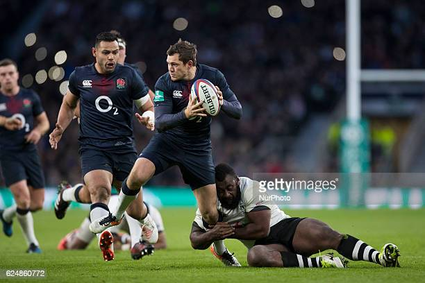 Alex Goode of England looks for a pass as Metuisela Tabebula of Fiji holds on from a tackle during Old Mutual Wealth Series between England and Fiji...