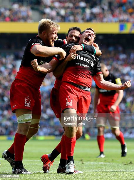Alex Goode of Saracens celebrates scoring his team's third try with his team mates during the Aviva Premiership final match between Saracens and...