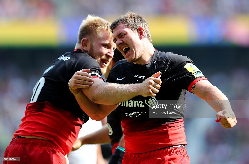 <a gi-track='captionPersonalityLinkClicked' href=/galleries/search?phrase=Alex+Goode&family=editorial&specificpeople=2060375 ng-click='$event.stopPropagation()'>Alex Goode</a> (R) of Saracens celebrates scoring his team's third try with his team mate <a gi-track='captionPersonalityLinkClicked' href=/galleries/search?phrase=Jackson+Wray&family=editorial&specificpeople=6179619 ng-click='$event.stopPropagation()'>Jackson Wray</a> (L) during the Aviva Premiership final match between Saracens and Exeter Chiefs at Twickenham Stadium on May 28, 2016 in London, England.