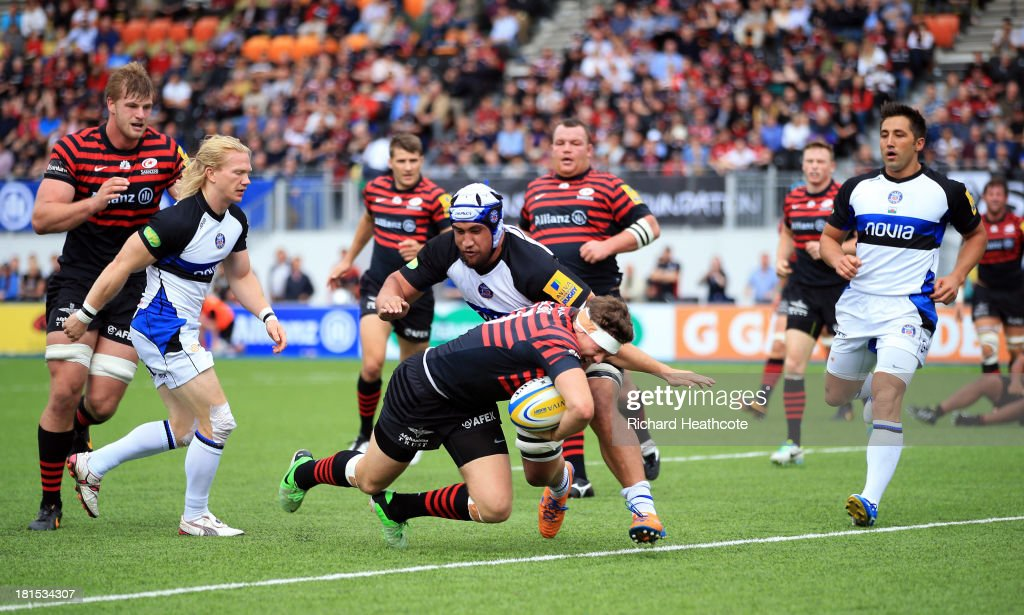 <a gi-track='captionPersonalityLinkClicked' href=/galleries/search?phrase=Alex+Goode&family=editorial&specificpeople=2060375 ng-click='$event.stopPropagation()'>Alex Goode</a> of Saracens dives over to score a try during the Aviva Premiership Rugby match between Saracens and Bath at the Allianz Park on September 22, 2013 in Barnet, England.