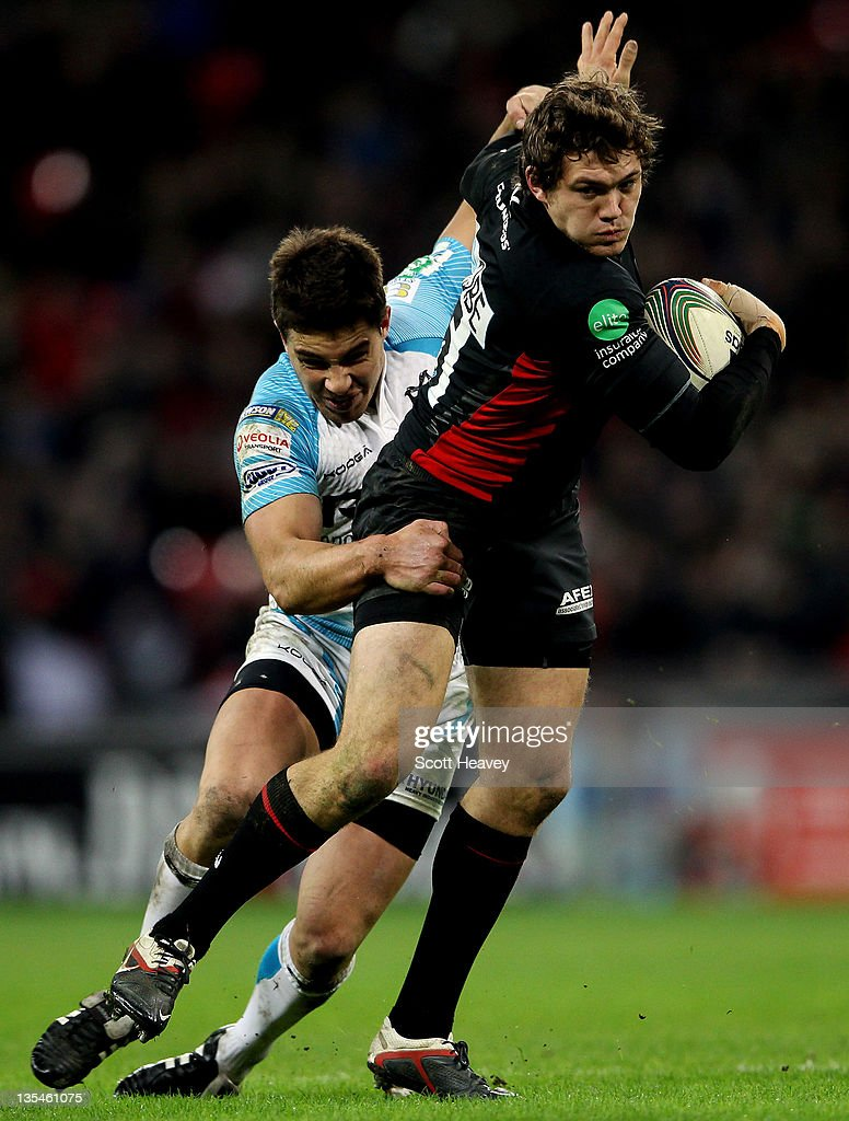 <a gi-track='captionPersonalityLinkClicked' href=/galleries/search?phrase=Alex+Goode&family=editorial&specificpeople=2060375 ng-click='$event.stopPropagation()'>Alex Goode</a> of Saracens (R) in action with Rhys Webb of Ospreys during the Heineken Cup Match between Saracens and Ospreys at Wembley Stadium on December 10, 2011 in London, England.