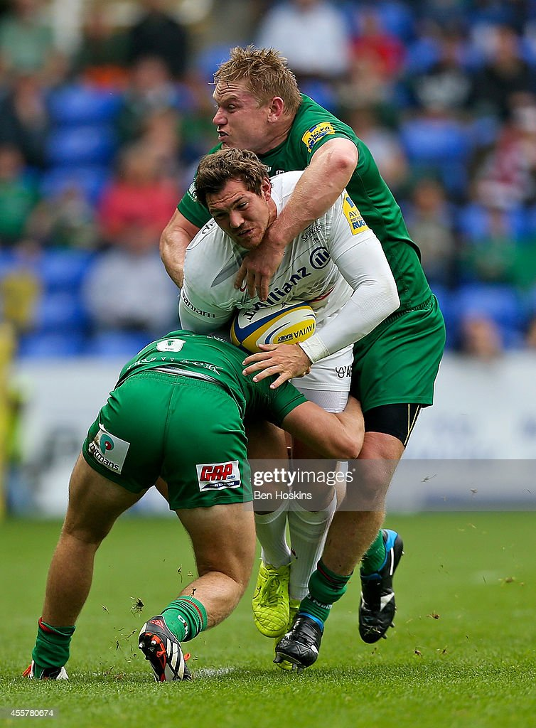<a gi-track='captionPersonalityLinkClicked' href=/galleries/search?phrase=Alex+Goode&family=editorial&specificpeople=2060375 ng-click='$event.stopPropagation()'>Alex Goode</a> of Saracens is tackled by Scott Steele (L) and <a gi-track='captionPersonalityLinkClicked' href=/galleries/search?phrase=Blair+Cowan&family=editorial&specificpeople=8840374 ng-click='$event.stopPropagation()'>Blair Cowan</a> (R) of London Irish during the Aviva Premiership match between London Irish and Saracens at Madejski Stadium on September 20, 2014 in Reading, England.