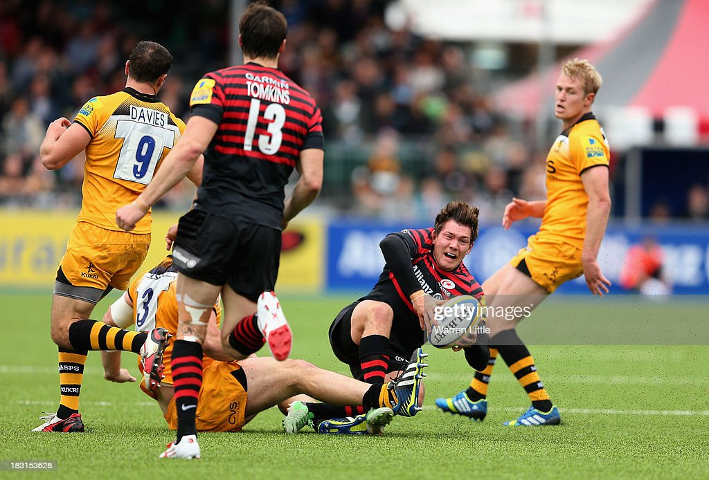 <a gi-track='captionPersonalityLinkClicked' href=/galleries/search?phrase=Alex+Goode&family=editorial&specificpeople=2060375 ng-click='$event.stopPropagation()'>Alex Goode</a> of Saracens is tackled during the Aviva Premiership match between Saracens and London Wasps at Allianz Park on October 5, 2013 in Barnet, England.