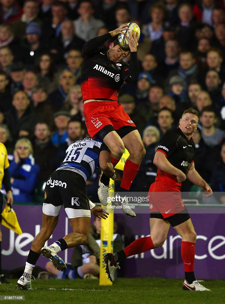 <a gi-track='captionPersonalityLinkClicked' href=/galleries/search?phrase=Alex+Goode&family=editorial&specificpeople=2060375 ng-click='$event.stopPropagation()'>Alex Goode</a> of Saracens is tackled in the air by Anthony Watson of Bath resulting in a red card during the Aviva Premiership match between Bath Rugby and Saracens at the Recreation Ground on April 1, 2016 in Bath, England.