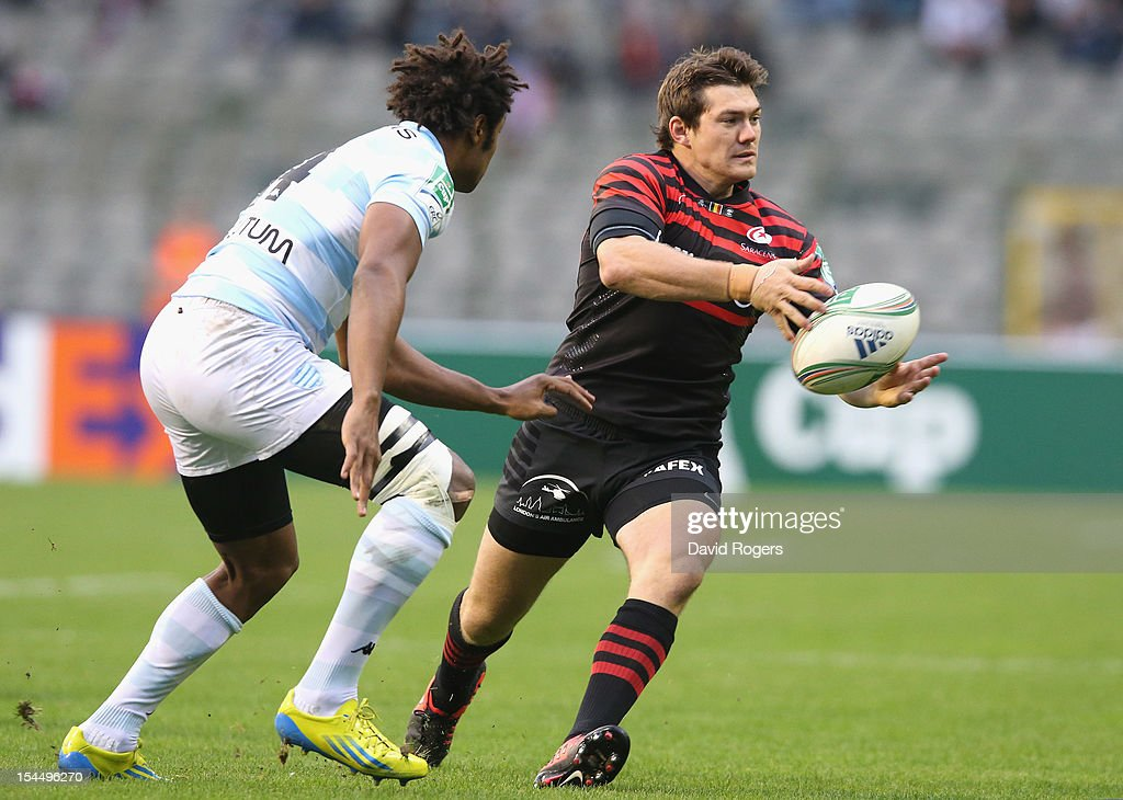 <a gi-track='captionPersonalityLinkClicked' href=/galleries/search?phrase=Alex+Goode&family=editorial&specificpeople=2060375 ng-click='$event.stopPropagation()'>Alex Goode</a> of Saracens runs with the ball as <a gi-track='captionPersonalityLinkClicked' href=/galleries/search?phrase=Benjamin+Fall&family=editorial&specificpeople=5405287 ng-click='$event.stopPropagation()'>Benjamin Fall</a> looks on during the Heineken Cup match between Saracens and Racing Metro at King Baudouin Stadium on October 20, 2012 in Brussels, Belgium.