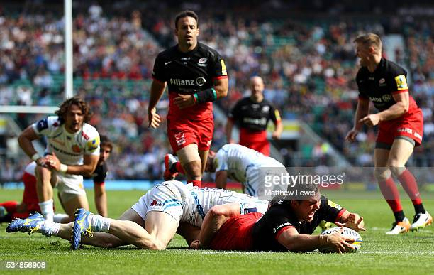 Alex Goode of Saracens scores his team's third try during the Aviva Premiership final match between Saracens and Exeter Chiefs at Twickenham Stadium...