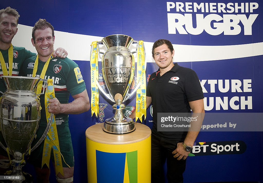 <a gi-track='captionPersonalityLinkClicked' href=/galleries/search?phrase=Alex+Goode&family=editorial&specificpeople=2060375 ng-click='$event.stopPropagation()'>Alex Goode</a> of Saracens stands with the Aviva Premiership Trophy during the 2013-14 Aviva Premiership Rugby Season Fixtures Announcement at The BT Tower on July 4, 2013 in London, England.
