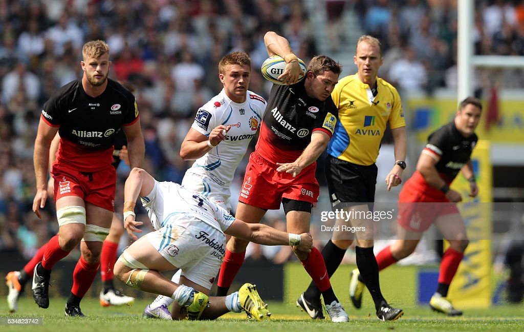 <a gi-track='captionPersonalityLinkClicked' href=/galleries/search?phrase=Alex+Goode&family=editorial&specificpeople=2060375 ng-click='$event.stopPropagation()'>Alex Goode</a> of Saracens takes on the Exeter Chiefs defence during the Aviva Premiership final match between Saracens and Exeter Chiefs at Twickenham Stadium on May 28, 2016 in London, England.