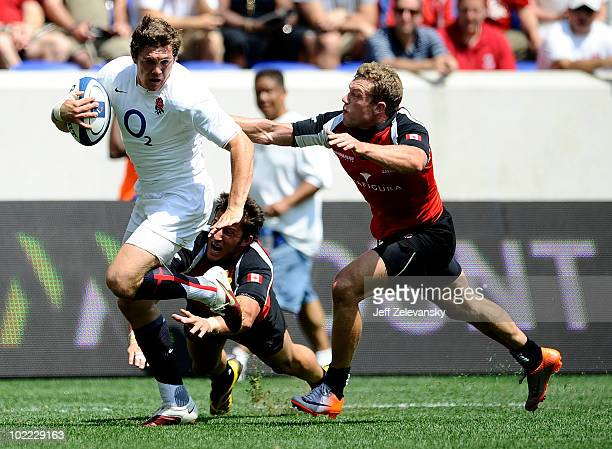 Alex Goode of the England Saxons runs in for a goal ahead of Phil Mackenzie of Canada during their Churchill Cup Final match at Red Bull Arena on...