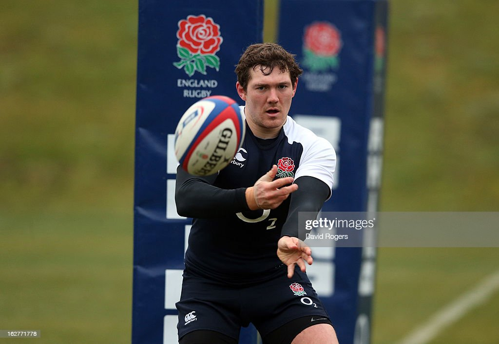 <a gi-track='captionPersonalityLinkClicked' href=/galleries/search?phrase=Alex+Goode&family=editorial&specificpeople=2060375 ng-click='$event.stopPropagation()'>Alex Goode</a> passes the ball during the England training session held at Pennyhill Park on February 26, 2013 in Bagshot, England.