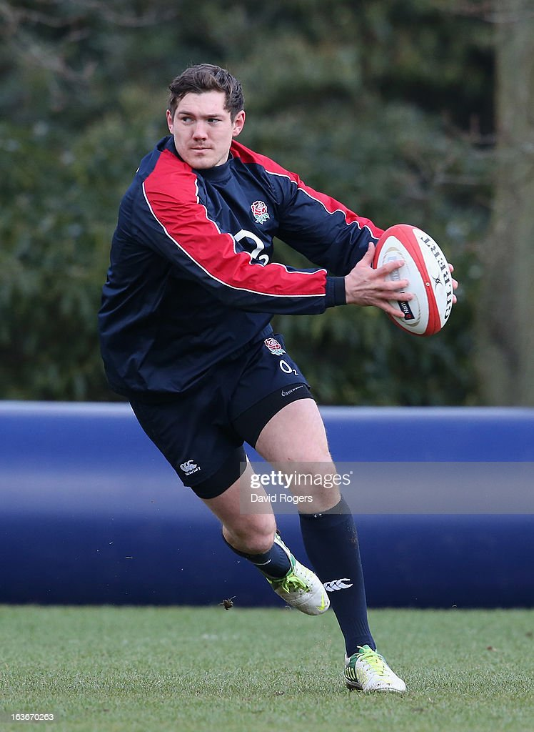 <a gi-track='captionPersonalityLinkClicked' href=/galleries/search?phrase=Alex+Goode&family=editorial&specificpeople=2060375 ng-click='$event.stopPropagation()'>Alex Goode</a> runs with the ball during the England training session at Pennyhill Park on March 14, 2013 in Bagshot, England.