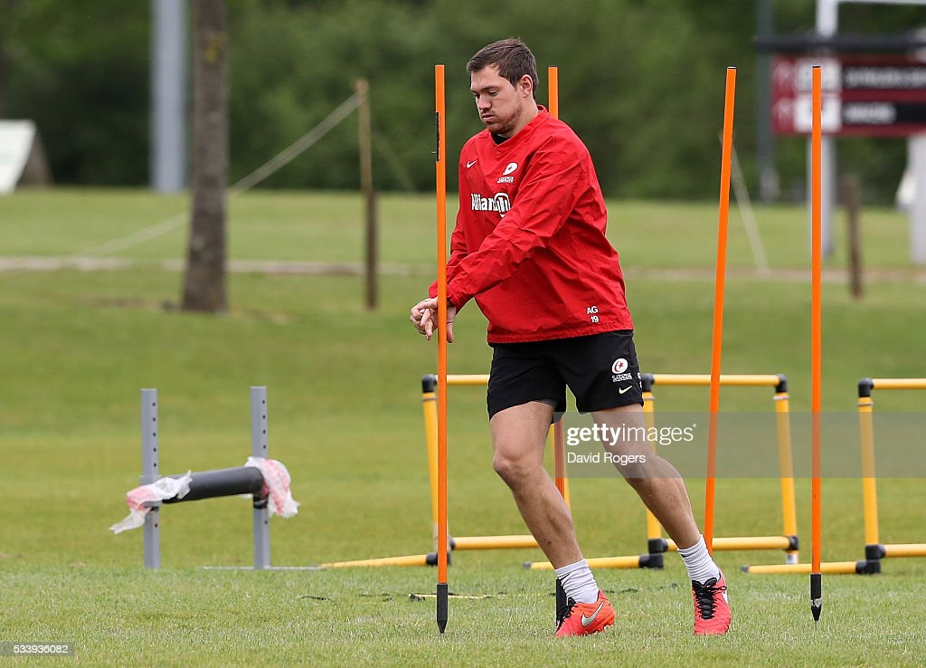 <a gi-track='captionPersonalityLinkClicked' href=/galleries/search?phrase=Alex+Goode&family=editorial&specificpeople=2060375 ng-click='$event.stopPropagation()'>Alex Goode</a> warms up during the Saracens training session held on May 24, 2016 in St Albans, England.