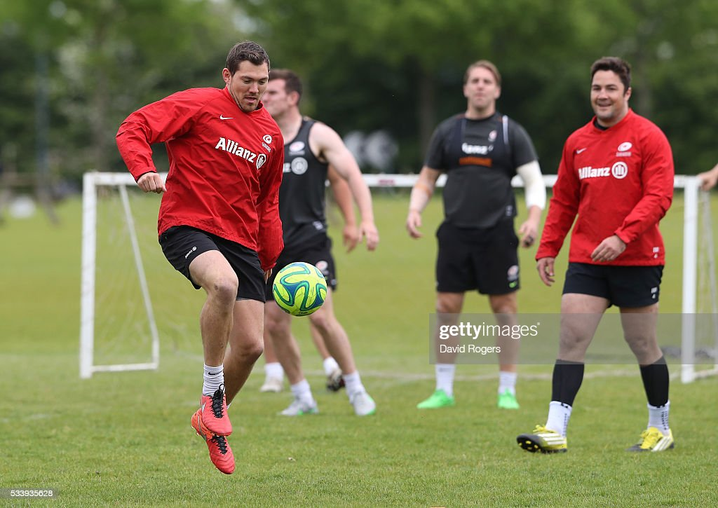 <a gi-track='captionPersonalityLinkClicked' href=/galleries/search?phrase=Alex+Goode&family=editorial&specificpeople=2060375 ng-click='$event.stopPropagation()'>Alex Goode</a> warms up playing football during the Saracens training session held on May 24, 2016 in St Albans, England.