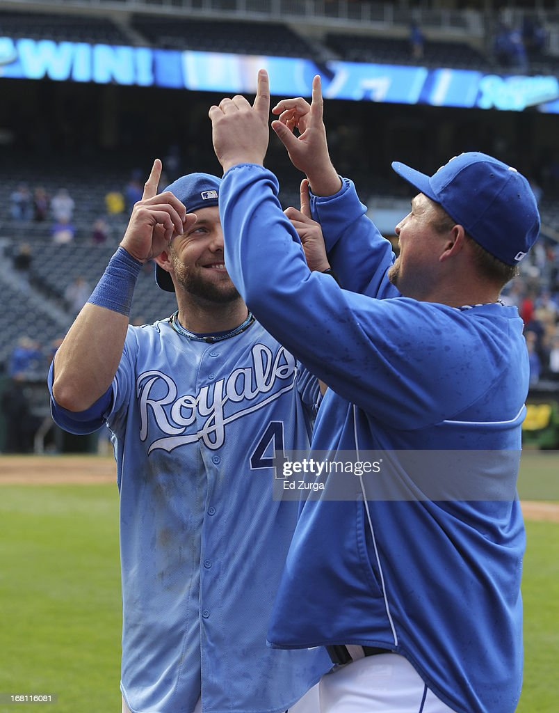 <a gi-track='captionPersonalityLinkClicked' href=/galleries/search?phrase=Alex+Gordon+-+Baseball+Player&family=editorial&specificpeople=4494252 ng-click='$event.stopPropagation()'>Alex Gordon</a> #4 and <a gi-track='captionPersonalityLinkClicked' href=/galleries/search?phrase=Billy+Butler&family=editorial&specificpeople=759092 ng-click='$event.stopPropagation()'>Billy Butler</a> of the Kansas City Royals celebrate a 6-5 win in 10 innings against the Chicago White Sox at Kauffman Stadium on May 5, 2013 in Kansas City, Missouri.