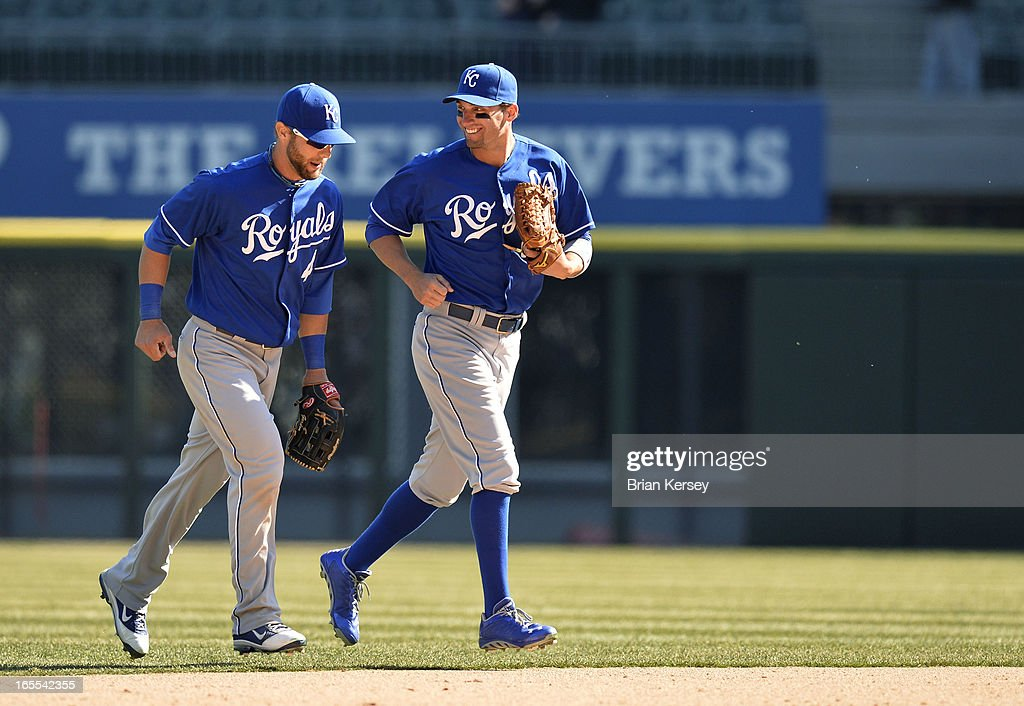 Alex Gordon #4 (L) and Jeff Francoeur #21 of the Kansas City Royals run off the field after defeating the Chicago White Sox on April 4, 2012 at U.S. Cellular Field in Chicago, Illinois. The Royals defeated the White Sox 3-1.