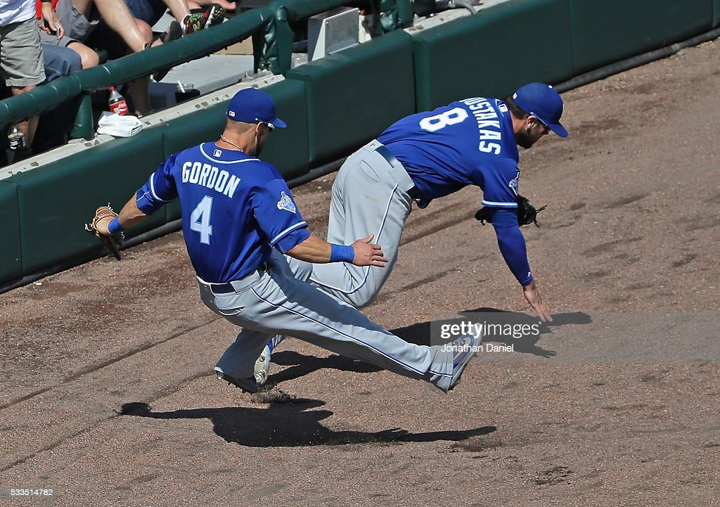 <a gi-track='captionPersonalityLinkClicked' href=/galleries/search?phrase=Alex+Gordon+-+Baseball+Player&family=editorial&specificpeople=4494252 ng-click='$event.stopPropagation()'>Alex Gordon</a> #4 and <a gi-track='captionPersonalityLinkClicked' href=/galleries/search?phrase=Mike+Moustakas&family=editorial&specificpeople=6780077 ng-click='$event.stopPropagation()'>Mike Moustakas</a> #8 of the Kansas City Royals collide going for a foul ball against the Chicago White Sox at U.S. Cellular Field on May 22, 2016 in Chicago, Illinois. The White Sox defeated the Royals 3-2.