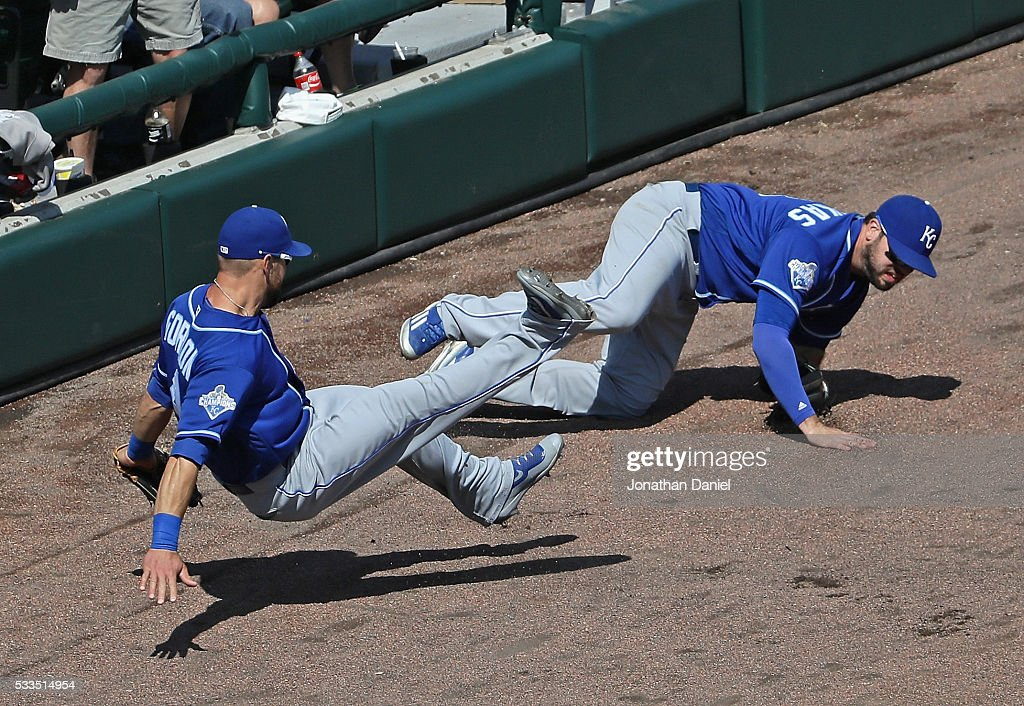 Alex Gordon #4 and Mike Moustakas #8 of the Kansas City Royals collide going for a foul ball against the Chicago White Sox at U.S. Cellular Field on May 22, 2016 in Chicago, Illinois. The White Sox defeated the Royals 3-2.