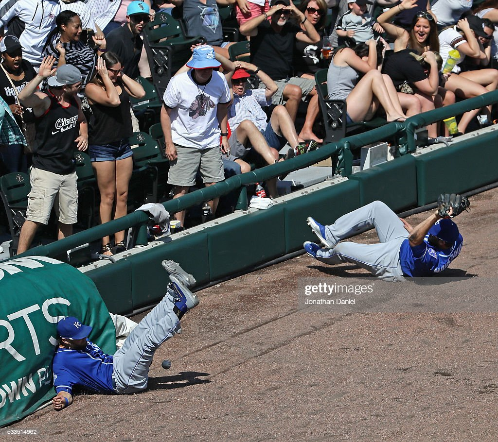 <a gi-track='captionPersonalityLinkClicked' href=/galleries/search?phrase=Alex+Gordon+-+Baseball&family=editorial&specificpeople=4494252 ng-click='$event.stopPropagation()'>Alex Gordon</a> #4 and <a gi-track='captionPersonalityLinkClicked' href=/galleries/search?phrase=Mike+Moustakas&family=editorial&specificpeople=6780077 ng-click='$event.stopPropagation()'>Mike Moustakas</a> #8 of the Kansas City Royals collide going for a foul ball against the Chicago White Sox at U.S. Cellular Field on May 22, 2016 in Chicago, Illinois. The White Sox defeated the Royals 3-2.