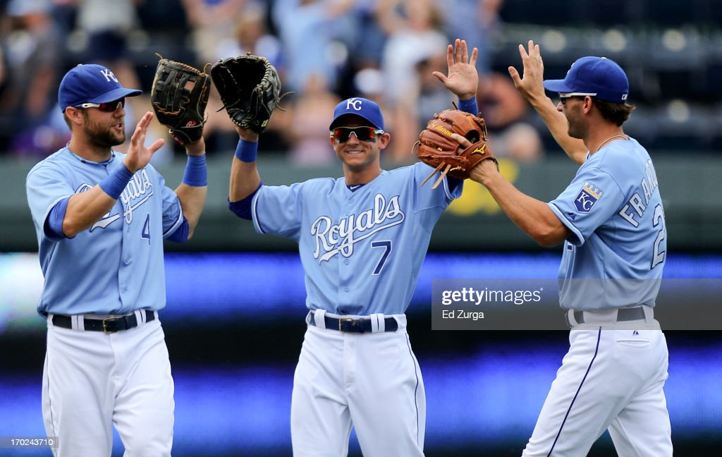 <a gi-track='captionPersonalityLinkClicked' href=/galleries/search?phrase=Alex+Gordon+-+Baseball+Player&family=editorial&specificpeople=4494252 ng-click='$event.stopPropagation()'>Alex Gordon</a> #4, <a gi-track='captionPersonalityLinkClicked' href=/galleries/search?phrase=David+Lough&family=editorial&specificpeople=6780100 ng-click='$event.stopPropagation()'>David Lough</a> #7 and <a gi-track='captionPersonalityLinkClicked' href=/galleries/search?phrase=Jeff+Francoeur&family=editorial&specificpeople=217574 ng-click='$event.stopPropagation()'>Jeff Francoeur</a> #21 of the Kansas City Royals celebrate a 2-0 win over the Houston Astros at Kauffman Stadium on June 9, 2013 in Kansas City, Missouri.
