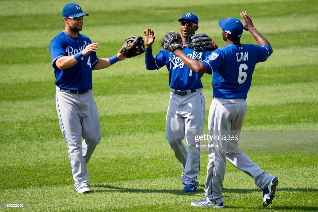 <a gi-track='captionPersonalityLinkClicked' href=/galleries/search?phrase=Alex+Gordon+-+Baseball+Player&family=editorial&specificpeople=4494252 ng-click='$event.stopPropagation()'>Alex Gordon</a> #4 Jarrod Dyson #1 and <a gi-track='captionPersonalityLinkClicked' href=/galleries/search?phrase=Lorenzo+Cain&family=editorial&specificpeople=5746615 ng-click='$event.stopPropagation()'>Lorenzo Cain</a> #6 of the Kansas City Royals celebrate after defeating the Cleveland Indians at Progressive Field on September 11, 2013 in Cleveland, Ohio. The Royals defeated the Indians 6-2.