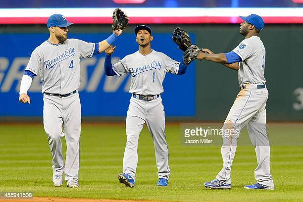 Alex Gordon Jarrod Dyson and Lorenzo Cain of the Kansas City Royals celebrate after the Royals defeated the Cleveland Indians at Progressive Field on...