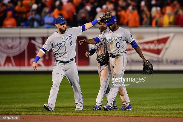 Alex Gordon Jarrod Dyson and Lorenzo Cain of the Kansas City Royals celebrate defeat the Baltimore Orioles 6 to 4 in Game Two of the American League...