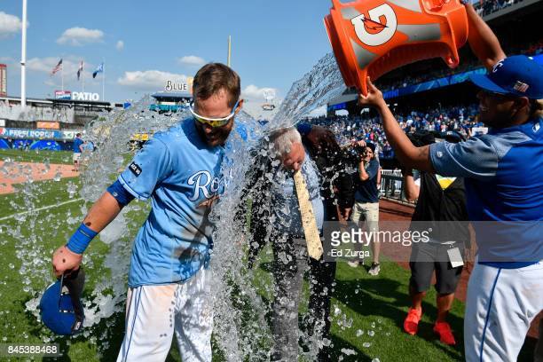 Alex Gordon of the Kansas City Royals and Fox Sports' Joel Goldberg are doused with water by Salvador Perez after a 113 win over the Minnesota Twins...
