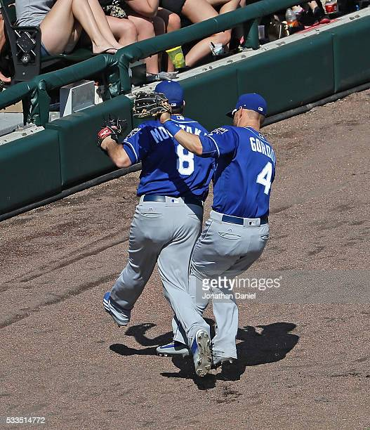 Alex Gordon of the Kansas City Royals and Mike Moustakas collide going for a foul ball against the Chicago White Sox at US Cellular Field on May 22...