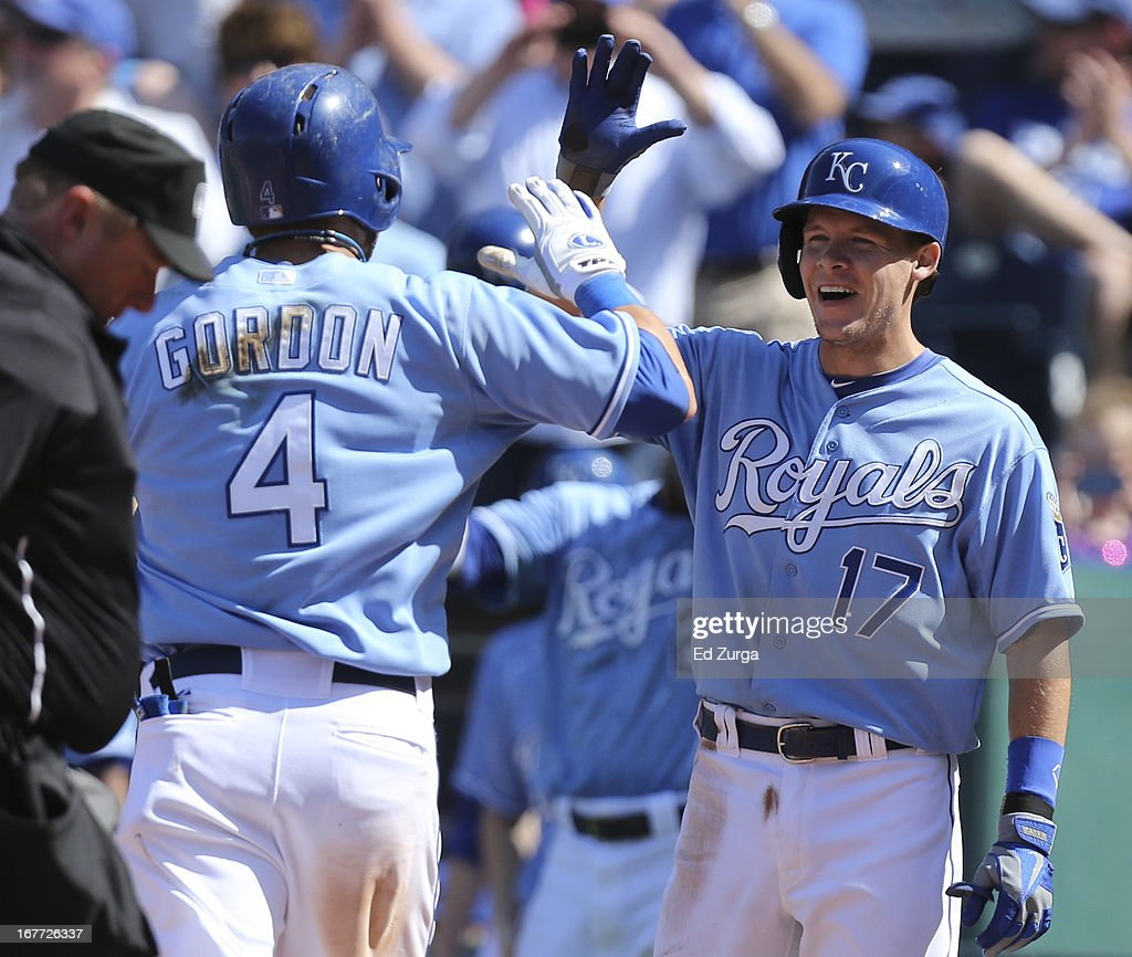 <a gi-track='captionPersonalityLinkClicked' href=/galleries/search?phrase=Alex+Gordon+-+Baseball+Player&family=editorial&specificpeople=4494252 ng-click='$event.stopPropagation()'>Alex Gordon</a> #4 of the Kansas City Royals celebrates his two-run home run with <a gi-track='captionPersonalityLinkClicked' href=/galleries/search?phrase=Chris+Getz&family=editorial&specificpeople=4936717 ng-click='$event.stopPropagation()'>Chris Getz</a> #17 in the eighth inning during game one of a doubleheader against the Cleveland Indians at Kauffman Stadium on April 28, 2013 in Kansas City, Missouri.