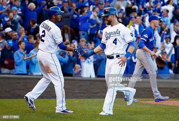 Alex Gordon of the Kansas City Royals celebrates with Alcides Escobar of the Kansas City Royals after scoring a run in the seventh inning against the...
