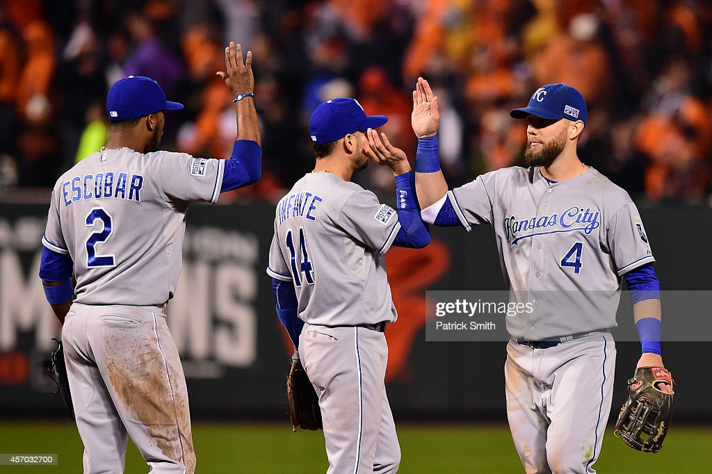Alex Gordon #4 of the Kansas City Royals celebrates with his teammates <a gi-track='captionPersonalityLinkClicked' href=/galleries/search?phrase=Omar+Infante&family=editorial&specificpeople=203255 ng-click='$event.stopPropagation()'>Omar Infante</a> #14 and <a gi-track='captionPersonalityLinkClicked' href=/galleries/search?phrase=Alcides+Escobar&family=editorial&specificpeople=4845889 ng-click='$event.stopPropagation()'>Alcides Escobar</a> #2 after defeating the Baltimore Orioles 8 to 6 in Game One of the American League Championship Series at Oriole Park at Camden Yards on October 10, 2014 in Baltimore, Maryland.
