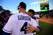 Alex Gordon of the Kansas City Royals celebrates with Norichika Aoki after their 2 to 1 win over the Baltimore Orioles to sweep the series in Game...