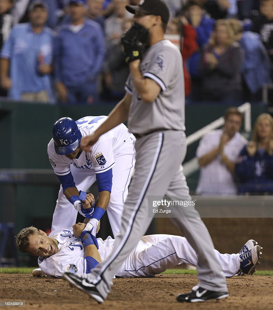 <a gi-track='captionPersonalityLinkClicked' href=/galleries/search?phrase=Alex+Gordon+-+Baseball+Player&family=editorial&specificpeople=4494252 ng-click='$event.stopPropagation()'>Alex Gordon</a> #4 of the Kansas City Royals celebrates with Salvador Perez #13 after scoring as <a gi-track='captionPersonalityLinkClicked' href=/galleries/search?phrase=Nate+Jones+-+Baseball+Player&family=editorial&specificpeople=14648396 ng-click='$event.stopPropagation()'>Nate Jones</a> #65 of the Chicago White Sox walks back to the mound in the sixth inning at Kauffman Stadium on September 20, 2012 in Kansas City, Missouri.