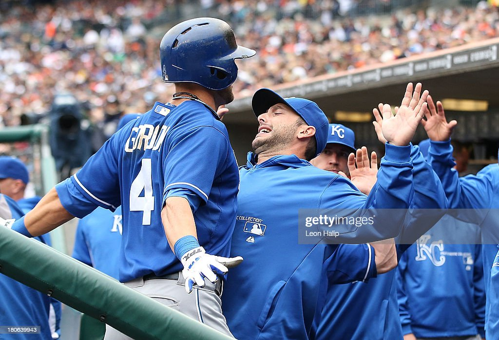 <a gi-track='captionPersonalityLinkClicked' href=/galleries/search?phrase=Alex+Gordon+-+Baseball+Player&family=editorial&specificpeople=4494252 ng-click='$event.stopPropagation()'>Alex Gordon</a> #4 of the Kansas City Royals celebrates with teammate <a gi-track='captionPersonalityLinkClicked' href=/galleries/search?phrase=George+Kottaras&family=editorial&specificpeople=730633 ng-click='$event.stopPropagation()'>George Kottaras</a> #26 after hitting a solo home run to left field in the fourth inning of the game at Comerica Park on September 15, 2013 in Detroit, Michigan.
