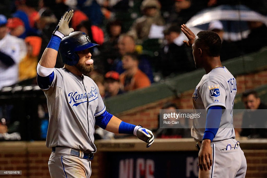 Alex Gordon #4 of the Kansas City Royals celebrates with teammate <a gi-track='captionPersonalityLinkClicked' href=/galleries/search?phrase=Jarrod+Dyson&family=editorial&specificpeople=6780110 ng-click='$event.stopPropagation()'>Jarrod Dyson</a> #1 after hitting a solo home run to right field in the tenth inning against Darren O'Day #56 of the Baltimore Orioles during Game One of the American League Championship Series at Oriole Park at Camden Yards on October 10, 2014 in Baltimore, Maryland.