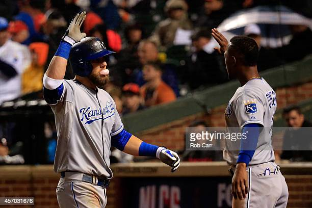 Alex Gordon of the Kansas City Royals celebrates with teammate Jarrod Dyson after hitting a solo home run to right field in the tenth inning against...