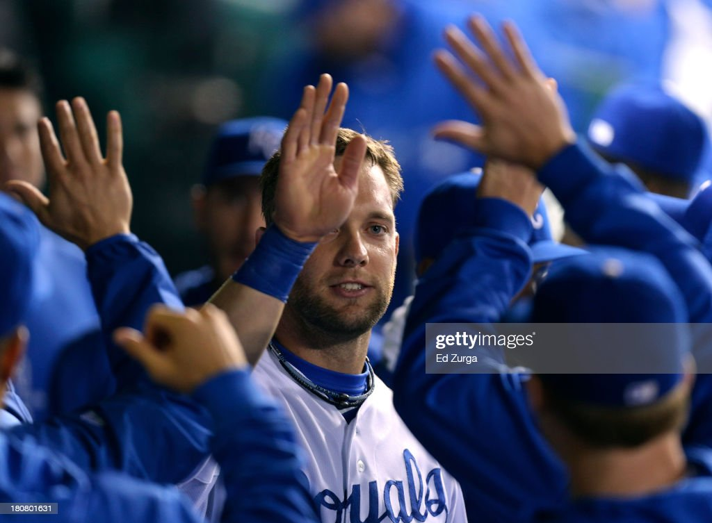 <a gi-track='captionPersonalityLinkClicked' href=/galleries/search?phrase=Alex+Gordon+-+Baseball+Player&family=editorial&specificpeople=4494252 ng-click='$event.stopPropagation()'>Alex Gordon</a> #4 of the Kansas City Royals celebrates with teammates after scoring on a Salvador Perez single in the third inning against the Cleveland Indians on September 16, 2013 at Kauffman Stadium in Kansas City, Missouri.