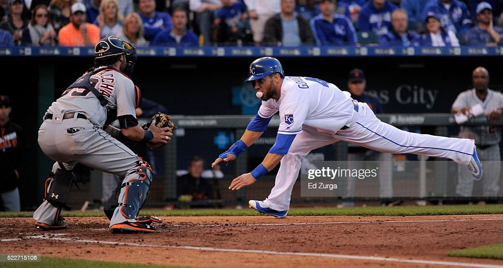 <a gi-track='captionPersonalityLinkClicked' href=/galleries/search?phrase=Alex+Gordon+-+Honkballer&family=editorial&specificpeople=4494252 ng-click='$event.stopPropagation()'>Alex Gordon</a> #4 of the Kansas City Royals dives into home against <a gi-track='captionPersonalityLinkClicked' href=/galleries/search?phrase=Jarrod+Saltalamacchia&family=editorial&specificpeople=836404 ng-click='$event.stopPropagation()'>Jarrod Saltalamacchia</a> #39 of the Detroit Tigers as he tries to score in the fifth inning at Kauffman Stadium on April 20, 2016 in Kansas City, Missouri. Gordon was tagged out on the play.